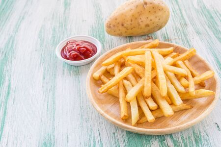 Close up french fries on a wooden background Stock Photo