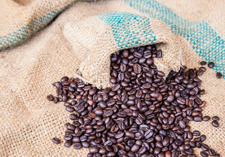 sackcloth: Coffee beans in coffee bag on sack surface background