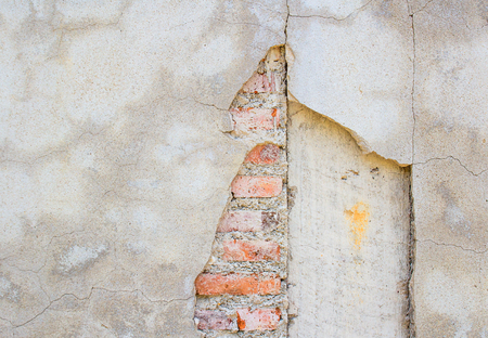 flaw: Grunge cracked concrete wall texture and background