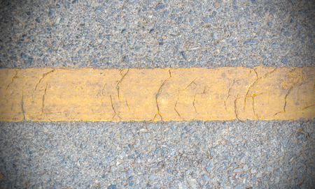 bumpy: Close up yellow line on the road texture Stock Photo