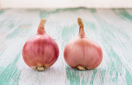 pealing: Fresh organic red onion on wooden background Stock Photo