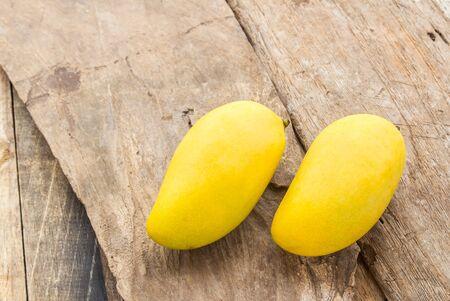 mango: Close up ripe mango on a wooden floor