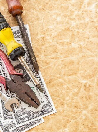 The dollar banknotes and tools on old paper background