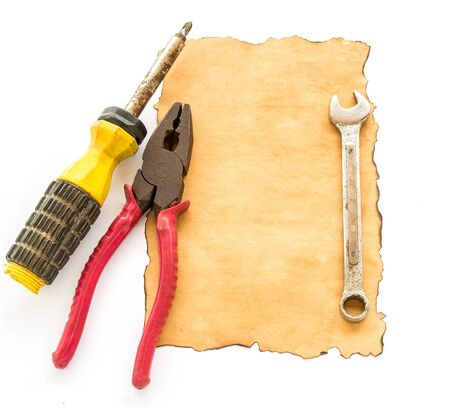 old document: Tools and old paper on a white background