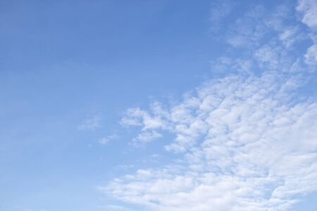 White clouds in the blue sky for any design