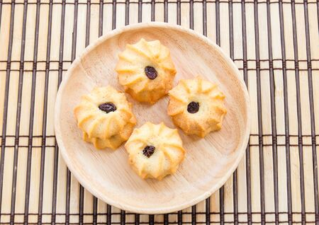 danish puff pastry: Cookies in wooden plate on wood table background