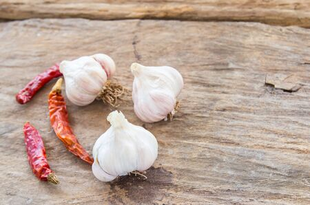 Garlic and dry chili on wooden table background Stock Photo