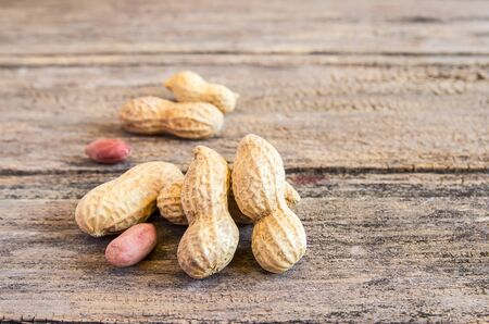 Close up peanuts on a wooden table background