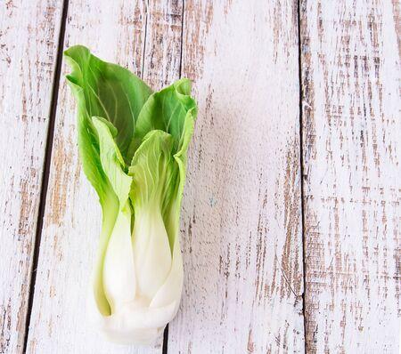 romaine: fresh leaves of romaine lettuce a white wooden table Stock Photo