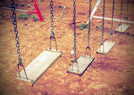 chain swing ride: Empty chain swing in the playground. Vintage filter