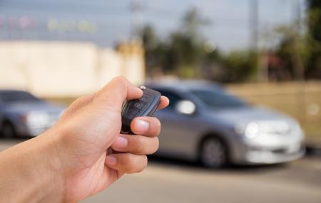holding close: Close up Hand holding car key