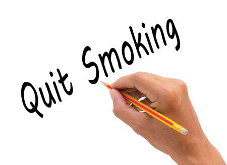 quit: Hand writing quit smoking word with pencil, health concept