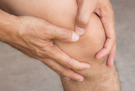 stiffness: Man with knee pain and feeling bad