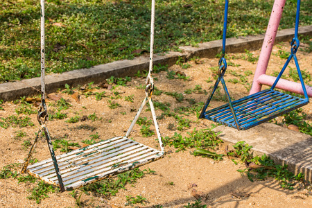 children play area: Closeup of swings in a children play area at park