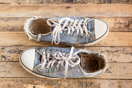 Dirty old shoes on a wooden floor