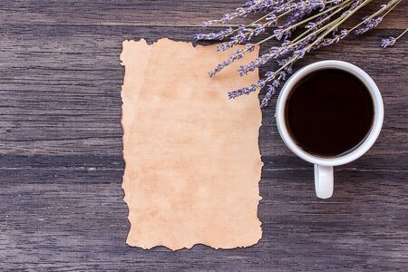 desperado: Old paper and coffee with lavender flower on dark wooden table background. top view with copy space