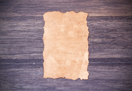 desperado: Old paper on dark wooden table background. top view with copy space Stock Photo