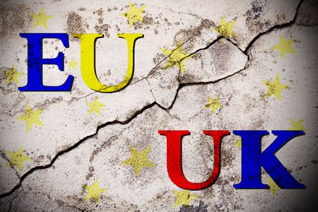 skepticism: Brexit european and uk text on broken wall. vote for united kingdom exit concept Stock Photo