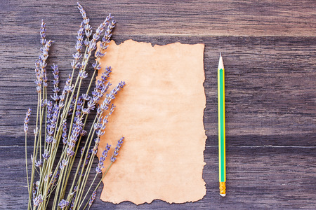 desperado: Lavender flower and old paper with pencil on the old wooden table background. top view with copy space Stock Photo