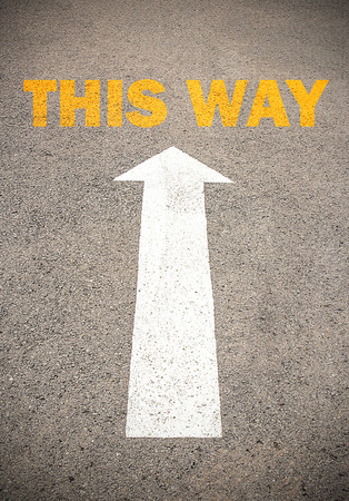 commence: Text for THIS WAY. Concept on the road surface marking with arrow, for any design