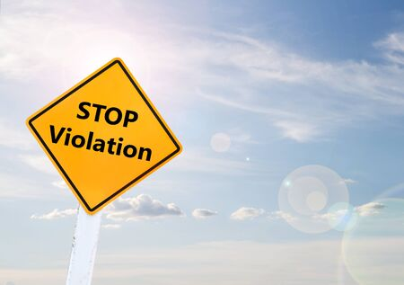 violaci�n: Text for STOP Violation on yellow road sign with blur blue sky background Foto de archivo