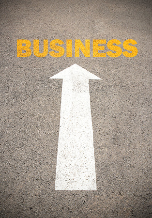 commence: Text for BUSINESS. Concept on the road surface marking with arrow, for any design Stock Photo