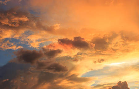 Fantastic red sunset and dark ominous clouds.Beautiful natural background and dramatic  blue cloudy sunset sky Stock Photo