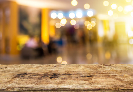 Selected focus perspective wood table and coffee shop blur background with bokeh image. for your photomontage or product display. Stock Photo