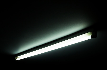 Detail of a fluorescent light tube on a wall. fluorescent light tube with copy space for any design 版權商用圖片