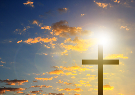 Silhouette cross in blue sky background symbol for easter sunday, christian and funeral.