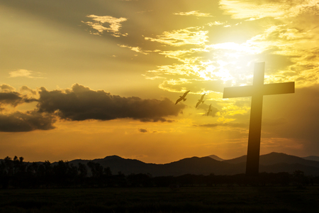 Silhouette cross on mountain sunset background. Abstract for belief break sin aim pain son of god saint Paul, he is risen in sunrise Easter day God calvary concept good friday.