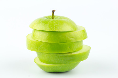 Close up green apple sliced isolated on white