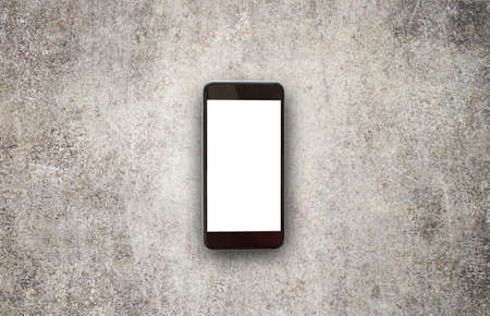 Mobile phone or smartphone with white screen on the cement floor. Copy space for insert text, Put on the floor. Modern smartphone with white screen, mockup Stock Photo