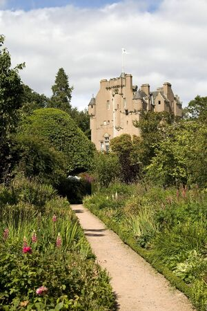 Medieval castle and gardens on a sunny day photo