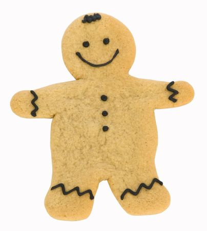 Gingerbread man with black icing isolated against white photo