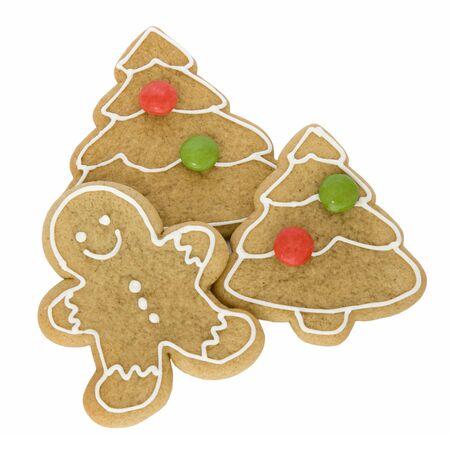 Navidad galletas de jengibre aislados contra blancos