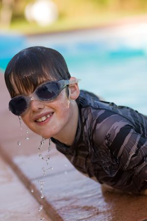 swimming goggles: Boy wearing swimming goggles
