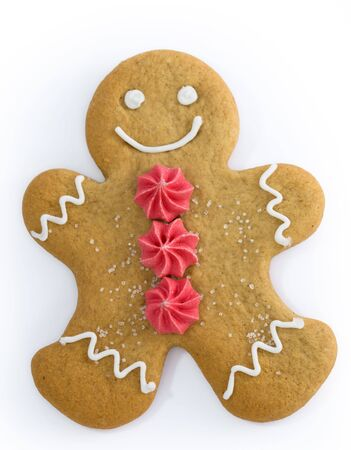 man made: Smiling gingerbread man with sugar flower buttons Stock Photo