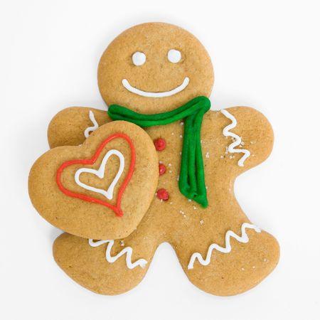 galletas de navidad: Smiling pan de jengibre hombre tiene coraz�n helado de jengibre
