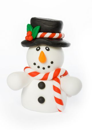 Cheerful snowman wearing top hat and striped scarf photo