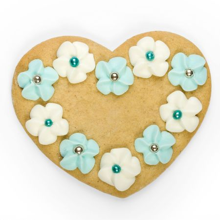 Heart shaped gingerbread cookie decorated with sugar flowers photo