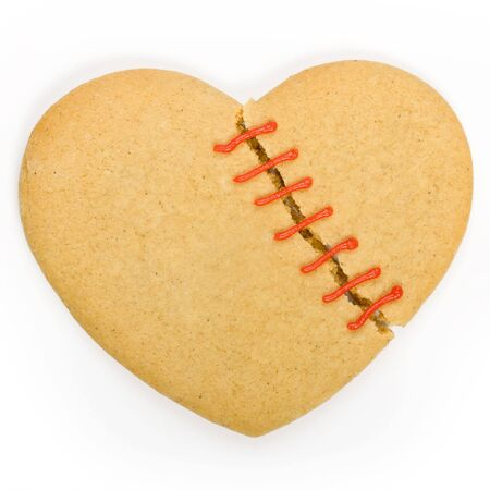Gingerbread cookie in the shape of a broken heart Stock Photo