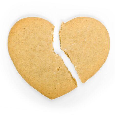 corazon roto: Galleta de jengibre en forma de un coraz�n roto Foto de archivo