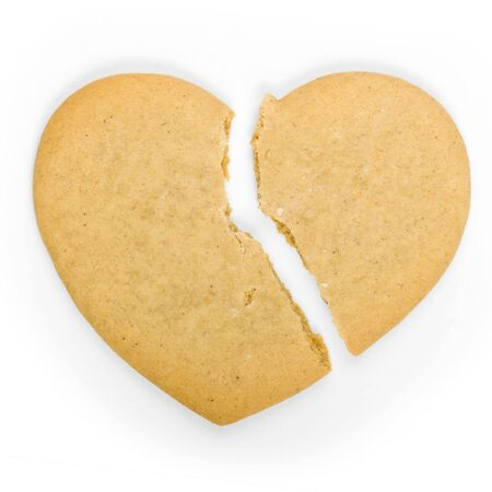 lonely heart: Gingerbread cookie in the shape of a broken heart Stock Photo