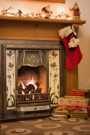 Victorian style fireplace ready for Christmas  photo