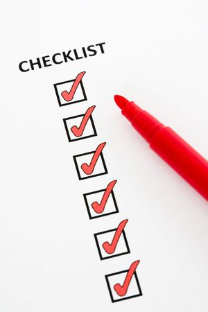 Checklist with checkboxes ticked using red pen photo