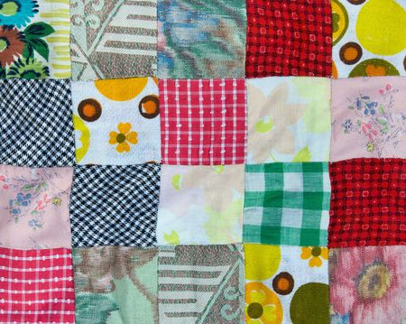 stitched: Section of a hand-stitched patchwork quilt Stock Photo