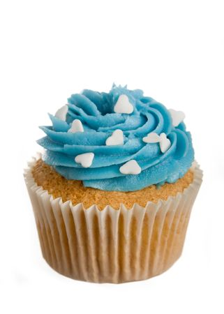 sprinkle: Cupcake decorated with frosting and white sugar hearts Stock Photo