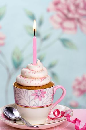Pink birthday cupcake in a teacup