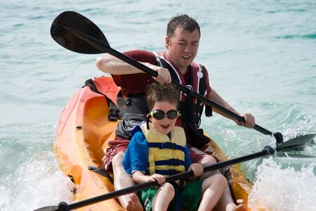Father and son enjoying a kayak trip Stock Photo
